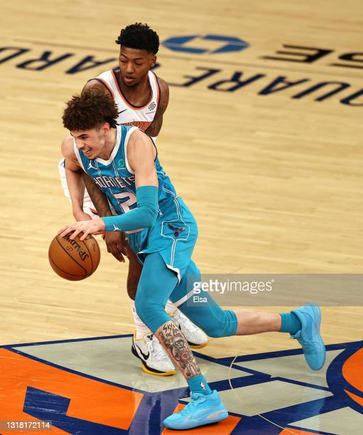 LaMelo Ball of the Charlotte Hornets drives around Elfrid Payton of the New York Knicks in the first quarter at Madison Square Garden on May 15, 2021...