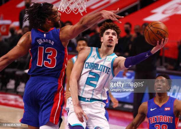 LaMelo Ball of the Charlotte Hornets drives to the basket against Jahlil Okafor of the Detroit Pistons during the first half at Little Caesars Arena...
