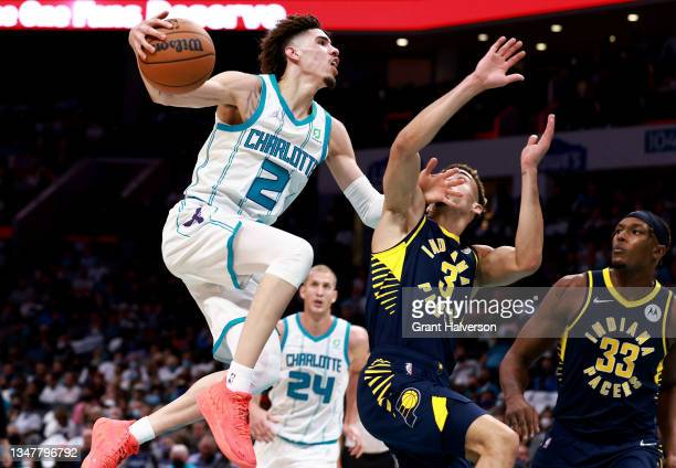 LaMelo Ball of the Charlotte Hornets drives to the basket against Chris Duarte of the Indiana Pacers during the second half of their game at Spectrum...