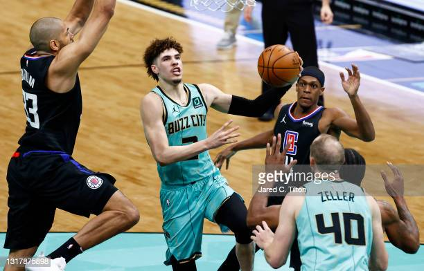 LaMelo Ball of the Charlotte Hornets drives to the basket during the third quarter of their game against the LA Clippers at Spectrum Center on May...