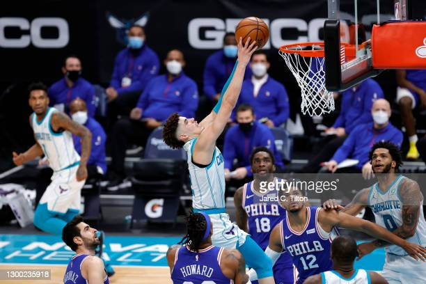 LaMelo Ball of the Charlotte Hornets dunks the ball during the fourth quarter of their game against the Philadelphia 76ers at Spectrum Center on...