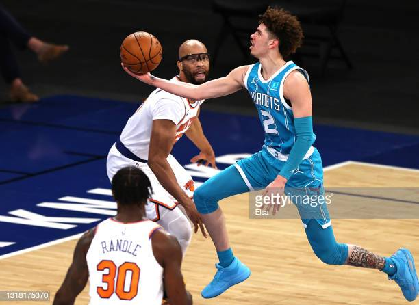 LaMelo Ball of the Charlotte Hornets heads for the net as Taj Gibson and Julius Randle of the New York Knicks defend in the second quarter at Madison...