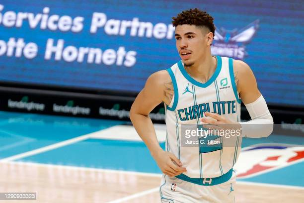 LaMelo Ball of the Charlotte Hornets looks on during the first half of their game at Spectrum Center on December 12, 2020 in Charlotte, North...