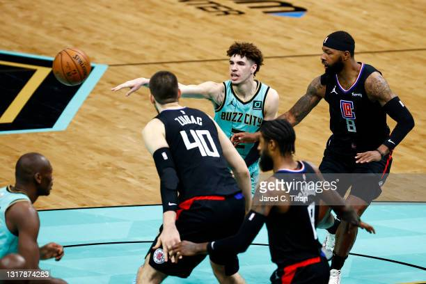 LaMelo Ball of the Charlotte Hornets looks to pass during the third quarter of their game against the LA Clippers at Spectrum Center on May 13, 2021...