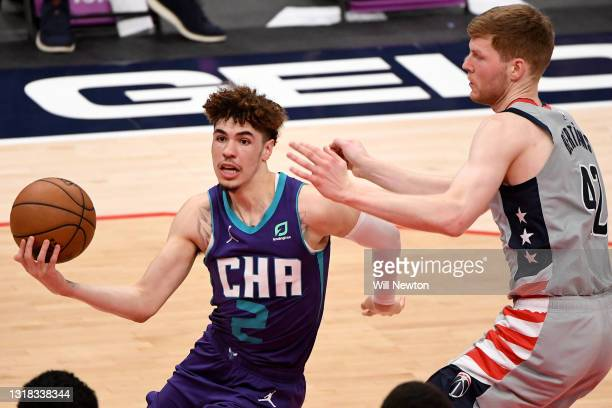 LaMelo Ball of the Charlotte Hornets looks to shoot in front of Davis Bertans of the Washington Wizards during the second half at Capital One Arena...