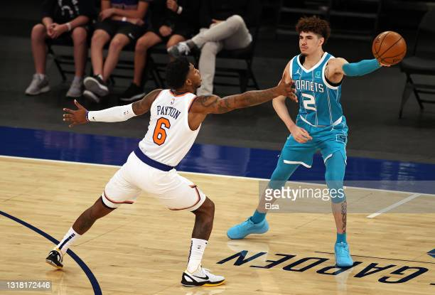 LaMelo Ball of the Charlotte Hornets passes the ball as Elfrid Payton of the New York Knicks defends in the first quarter at Madison Square Garden on...