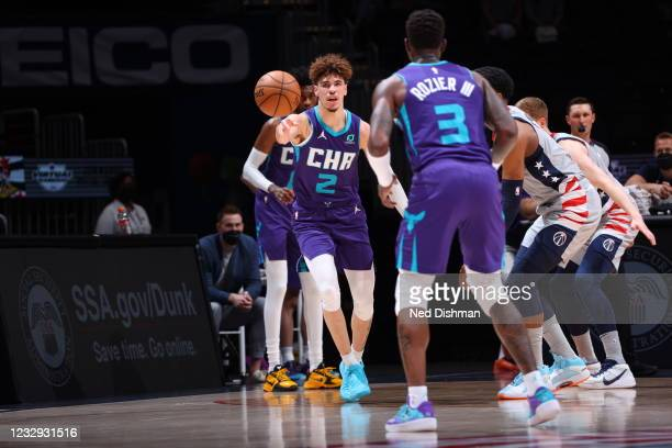 LaMelo Ball of the Charlotte Hornets passes the ball during the game against the Washington Wizards on May 16, 2021 at Capital One Arena in...