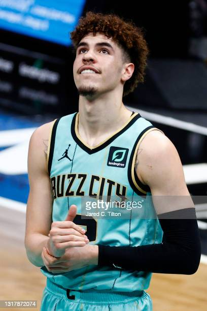 LaMelo Ball of the Charlotte Hornets reacts during the second quarter of their game against the LA Clippers at Spectrum Center on May 13, 2021 in...