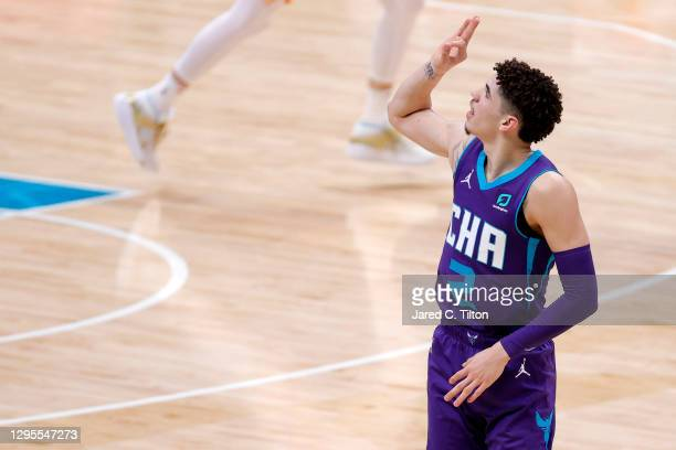 LaMelo Ball of the Charlotte Hornets reacts following a three point basket during the second quarter of their game against the Atlanta Hawks at...