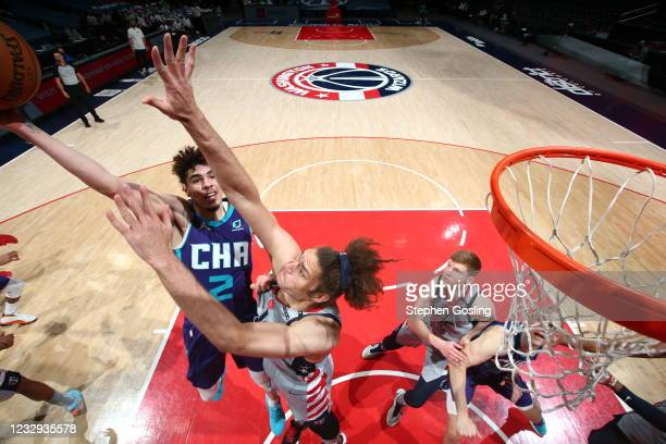 LaMelo Ball of the Charlotte Hornets shoots the ball during the game against the Washington Wizards on May 16, 2021 at Capital One Arena in...