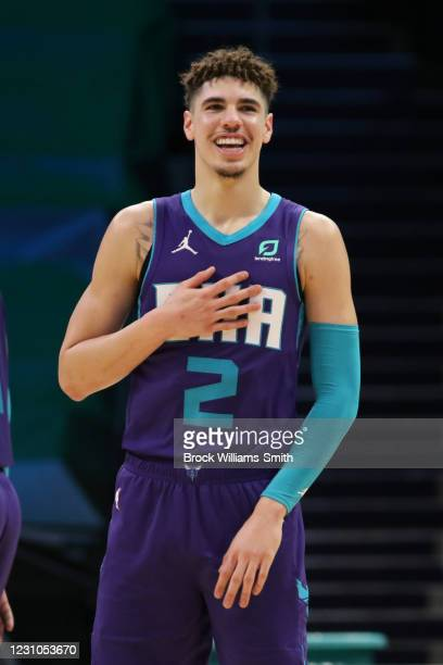 LaMelo Ball of the Charlotte Hornets smiles during the game against the Houston Rockets on February 8, 2021 at Spectrum Center in Charlotte, North...