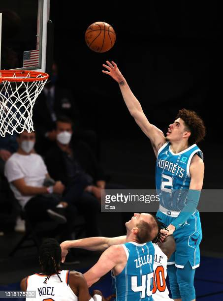 LaMelo Ball of the Charlotte Hornets takes a shot over Julius Randle and Nerlens Noel of the New York Knicks in the second quarter at Madison Square...
