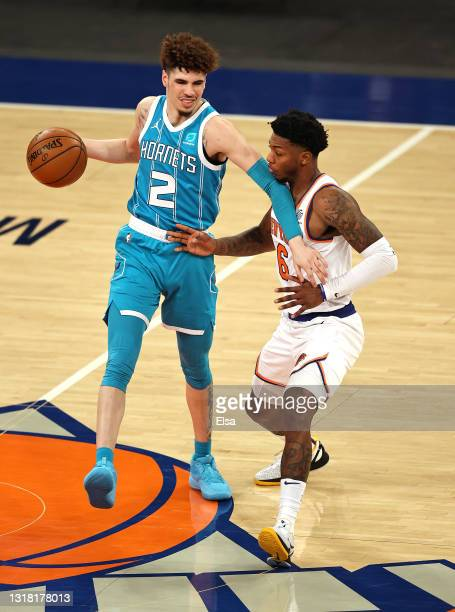 LaMelo Ball of the Charlotte Hornets tries to get past Elfrid Payton of the New York Knicks in the third quarter at Madison Square Garden on May 15,...