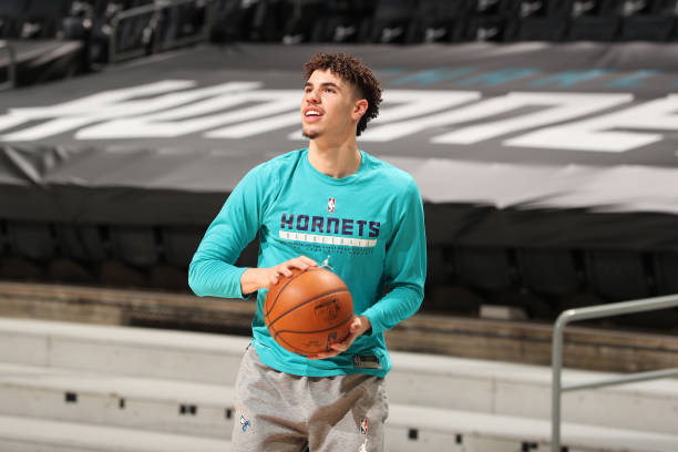 LaMelo Ball of the Charlotte Hornets warms up before the game against the Toronto Raptors on March 13, 2021 at Spectrum Center in Charlotte, North...