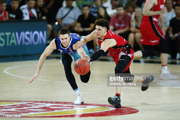 LaMelo Ball of the Hawks competes for the ball against Tom Abercrombie of the Breakers during the round 9 NBL match between the New Zealand Breakers...