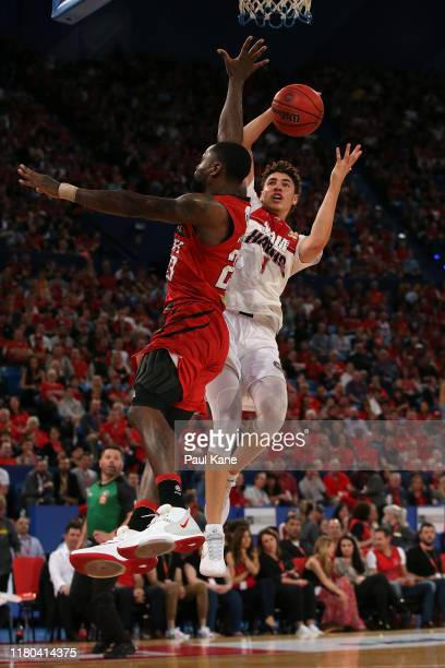 LaMelo Ball of the Hawks lays up against Terrico White of the Wildcats during the round two NBL match between the Perth Wildcats and the Illawarra...