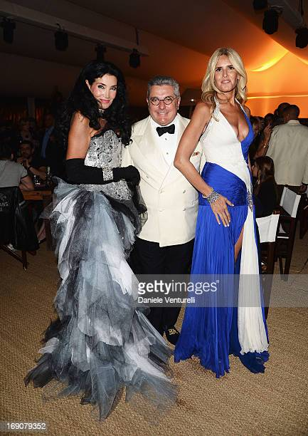 Lamia Khashoggi Nunzio Alfredo D'Angieri and Tiziana Rocca attend the Eva Longoria Global Gift Gala after party hosted by Nikki Beach Cannes during...