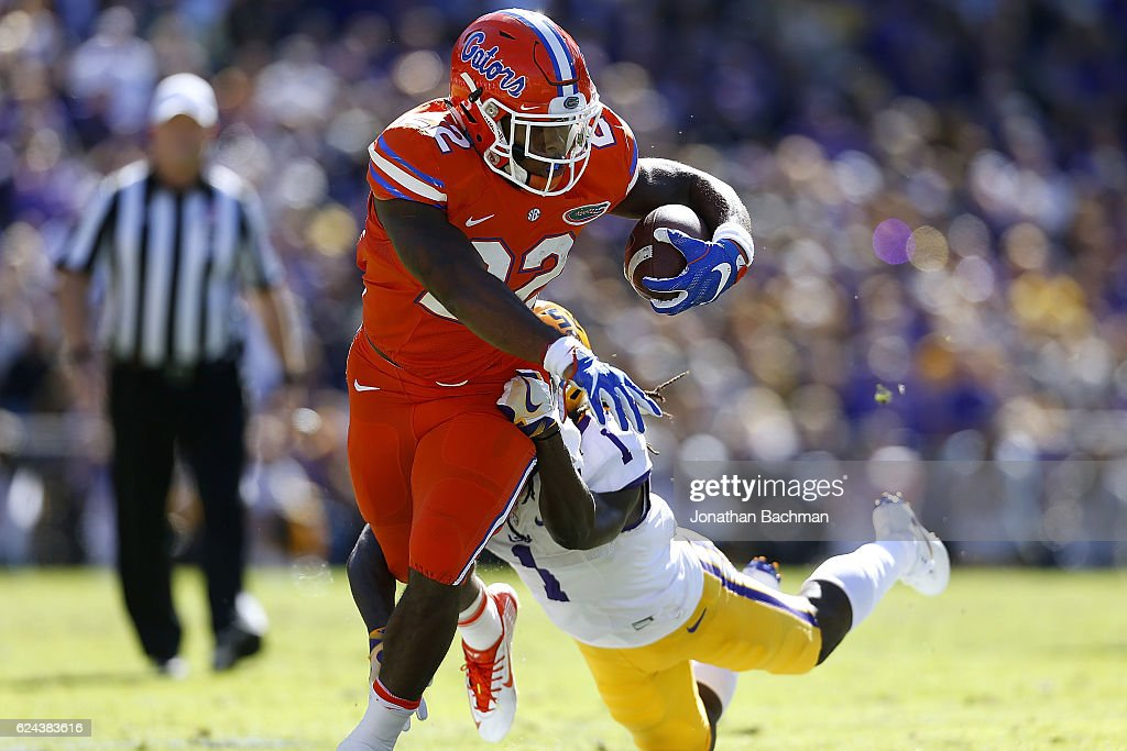 Lamical Perine #22 of the Florida Gators is tackled by Donte Jackson #1 of the LSU Tigers during the first half of a game at Tiger Stadium on November 19, 2016 in Baton Rouge, Louisiana.