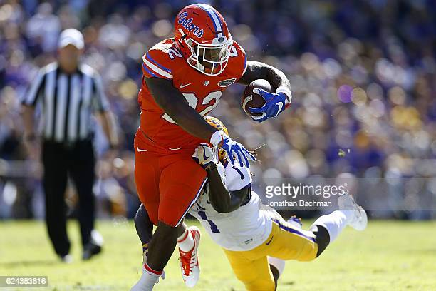 Lamical Perine of the Florida Gators is tackled by Donte Jackson of the LSU Tigers during the first half of a game at Tiger Stadium on November 19...
