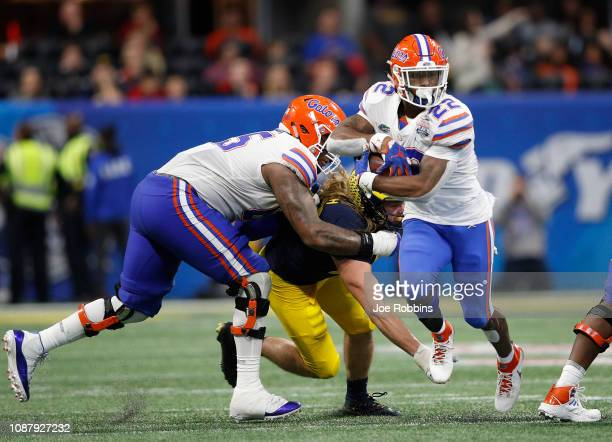 Lamical Perine of the Florida Gators runs for a fourth quarter touchdown against the Michigan Wolverines during the ChickfilA Peach Bowl at...