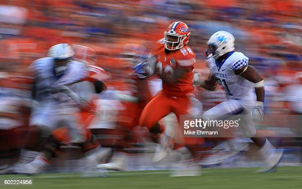 Lamical Perine of the Florida Gators rushes for a touchdown during a game against the Kentucky Wildcats at Ben Hill Griffin Stadium on September 10...