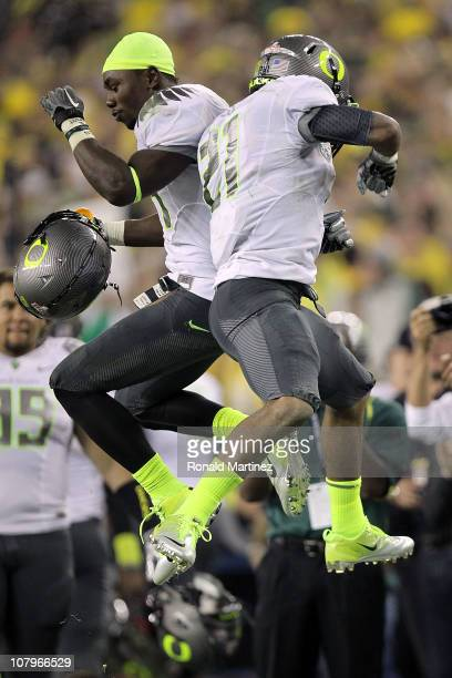LaMichael James and Kenjon Barner of the Oregon Ducks celebrate James' eight-yard touchdown reception in the second quarter against the Auburn Tigers...