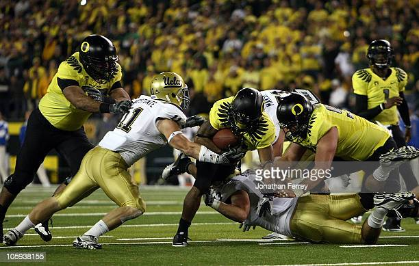 LaMichael James of the Oregon Ducks runs the ball against Sean Westgate of the UCLA Bruins on October 21 2010 at the Autzen Stadium in Eugene Oregon