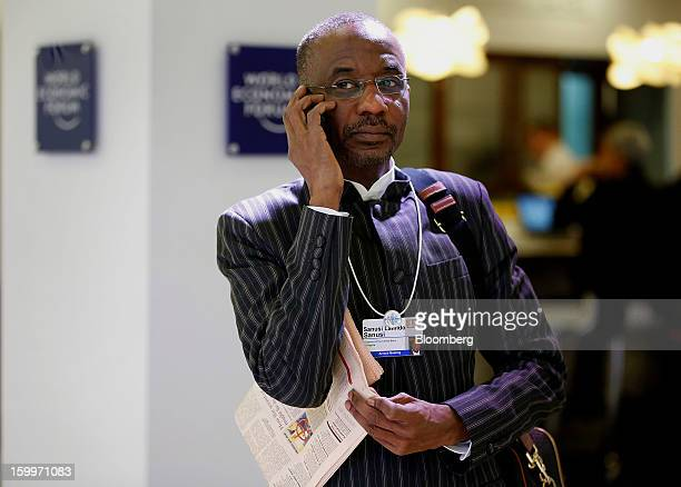 Lamido Sanusi governor of the Central Bank of Nigeria talks on his mobile phone in between sessions on day two of the World Economic Forum in Davos...