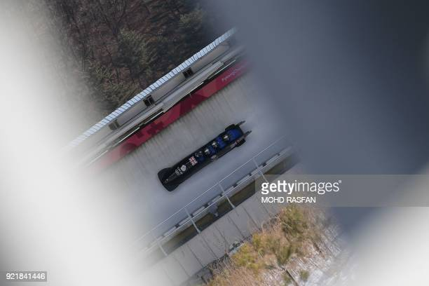 TOPSHOT Lamin Deen Andrew Matthews Toby Olubi and Ben Simons of Great Britain take part in a training session for the men's 4man bobsleigh during the...