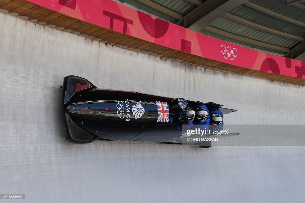 Lamin Deen, Andrew Matthews, Toby Olubi and Ben Simons of Great Britain take part in a training session for the men's 4-man bobsleigh during the Pyeongchang 2018 Winter Olympic Games, at the Olympic Sliding Centre in Pyeongchang on February 21, 2018. / AFP PHOTO / Mohd RASFAN