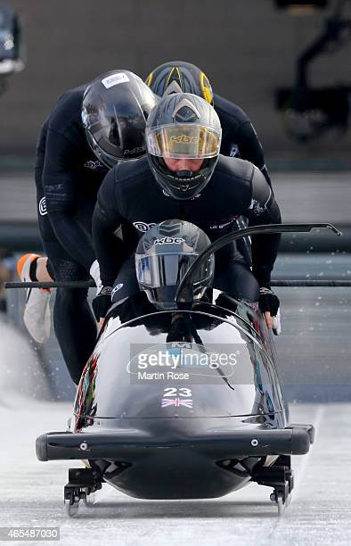 Lamin Deen Ben Simons Bruce Tasker and Andrew Matthews of Great Britain compete in their first run of the four man bob competition during the FIBT...