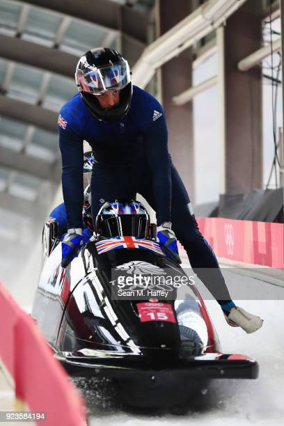 Lamin Deen Ben Simons Toby Olubi and Andrew Matthews of Great Britain react in the finish area during 4man Bobsleigh Heats on day fifteen of the...