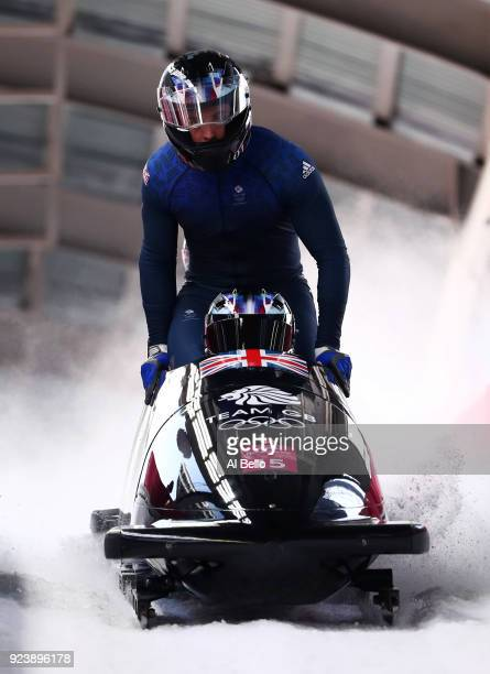 Lamin Deen Ben Simons Toby Olubi and Andrew Matthews of Great Britain finish their run during the 4man Boblseigh Heats on day sixteen of the...