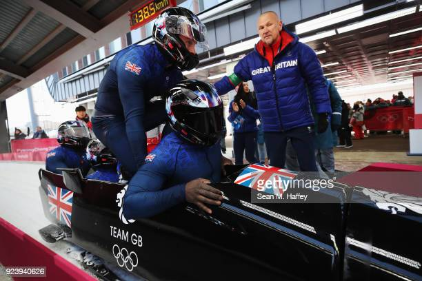 Lamin Deen Ben Simons Toby Olubi and Andrew Matthews of Great Britain finish their final run during the 4man Boblseigh heats on day sixteen of the...