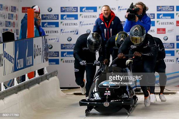 Lamin Deen John Baines Joel Fearon and Andrew Matthews of Great Britain compete in their first run of the four men's bob competition during the BMW...