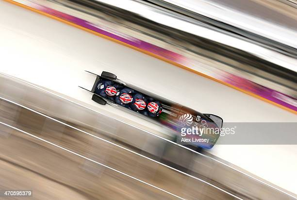 Lamin Deen of Great Britain pilots a run during a four-man bobsleigh practice session on Day 13 of the Sochi 2014 Winter Olympics at Sliding Center...