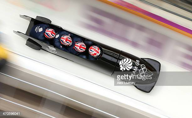 Lamin Deen of Great Britain pilots a run during a fourman bobsleigh practice session on Day 13 of the Sochi 2014 Winter Olympics at Sliding Center...