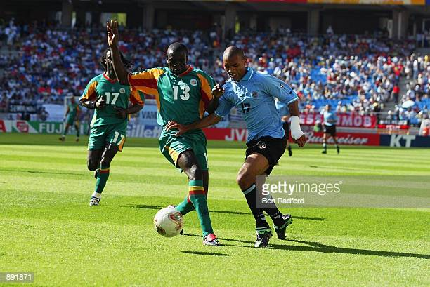 Lamine Diatta of Senegal competes for the ball with Mario Regueiro of Uruguay during the second half during the Uruguay v Senegal Group A World Cup...