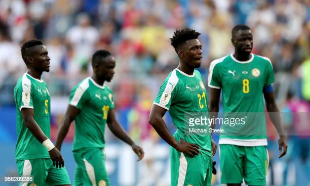 Lamine Gassama of Senegal looks dejected following his sides defeat in during the 2018 FIFA World Cup Russia group H match between Senegal and...