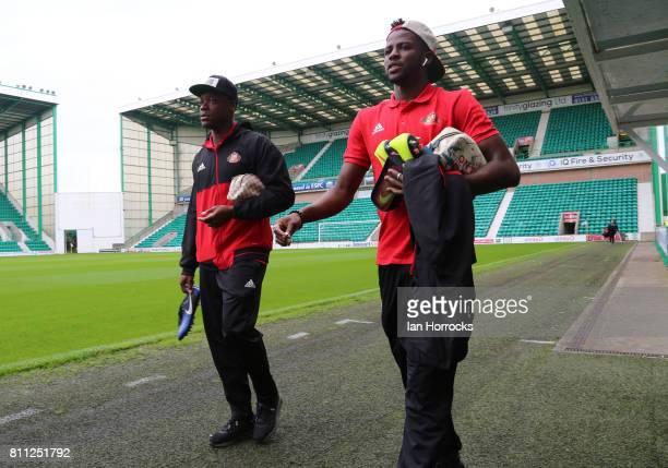 Lamine Kone and Papy Djilobodji of Sunderland arrive ahead of a preseason friendly between Hibernian FC and Sunderland AFC at Easter Road on July 9...