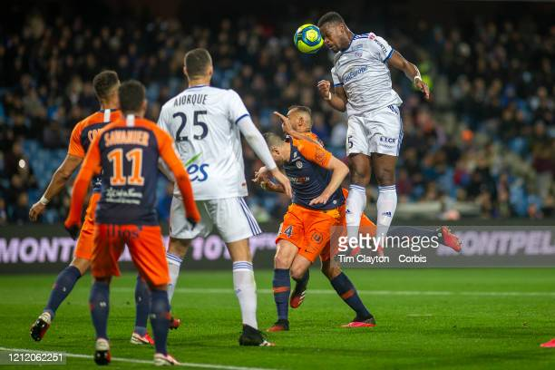 Lamine Kone of Strasbourg heads goal wards while challenged by Damien Le Tallec of Montpellier during the Montpellier V Strasbourg French Ligue 1...