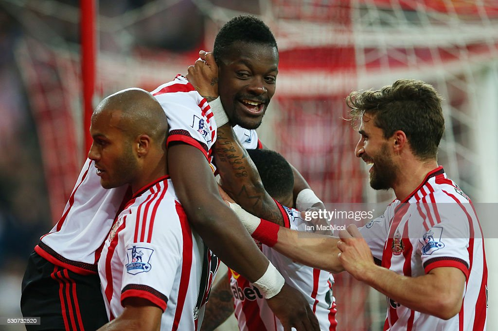 Lamine Kone of Sunderland celebrates scoring his team's third goal with team mates during the Barclays Premier League match between Sunderland and Everton at the Stadium of Light on May 11, 2016 in Sunderland, England.