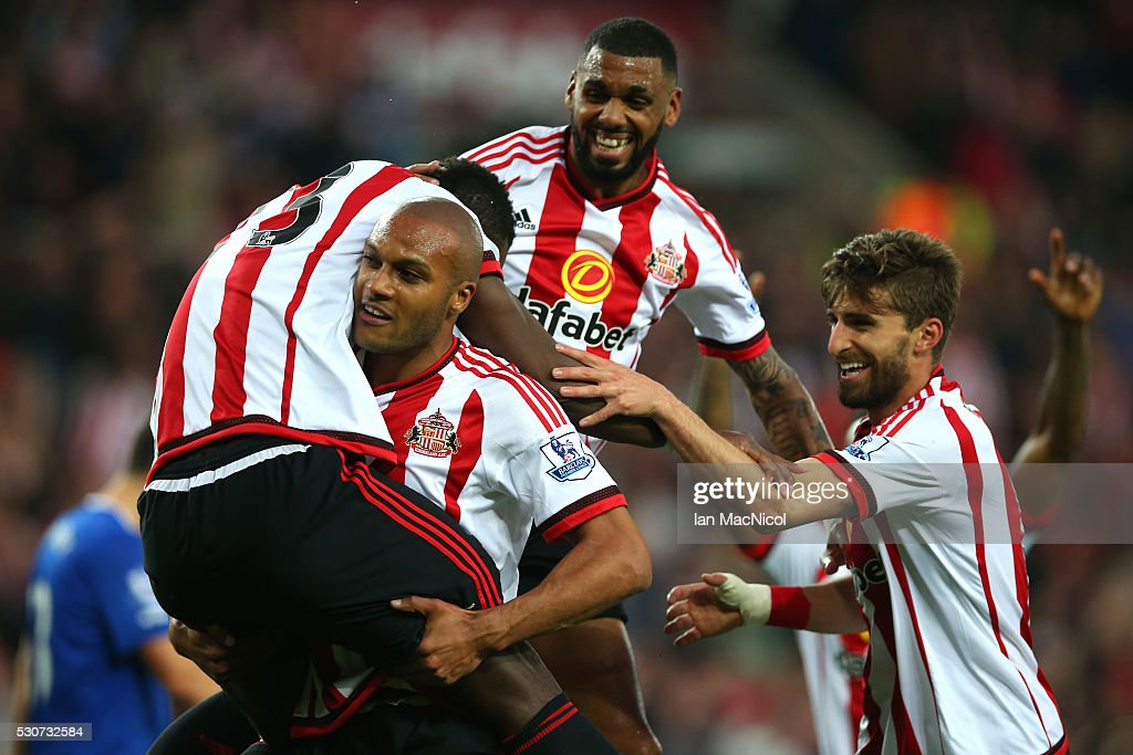 Lamine Kone (L) of Sunderland celebrates scoring his team's third goal with team mates during the Barclays Premier League match between Sunderland and Everton at the Stadium of Light on May 11, 2016 in Sunderland, England.