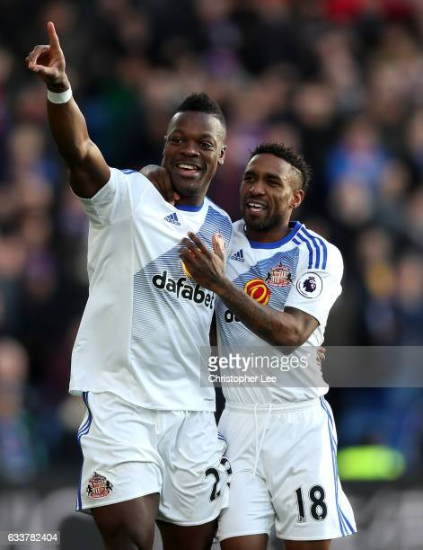 Lamine Kone of Sunderland celebrates scoring the opening goal with his team mate Jermain Defoe during the Premier League match between Crystal Palace...
