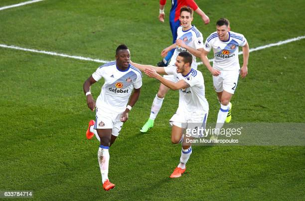 Lamine Kone of Sunderland celebrates scoring the opening goal with his team mates during the Premier League match between Crystal Palace and...