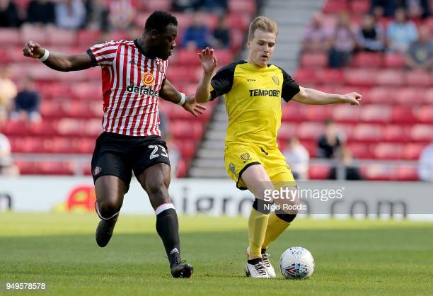 Lamine Kone of Sunderland challenges Damien McCrory of Burton Albion during the Sky Bet Championship match between Sunderland and Burton Albion at...