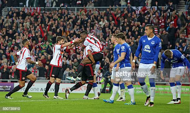 Lamine Kone of Sunderland is held aloft after he scores the third goal during the Barclays Premier League match between Sunderland and Everton at the...