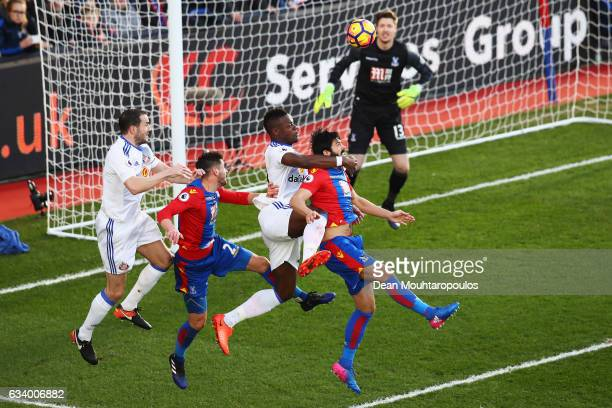 Lamine Kone of Sunderland jumps for a header with James Tomkins and Joel Ward of Crystal Palace and team mate John O'Shea of Sunderland during the...