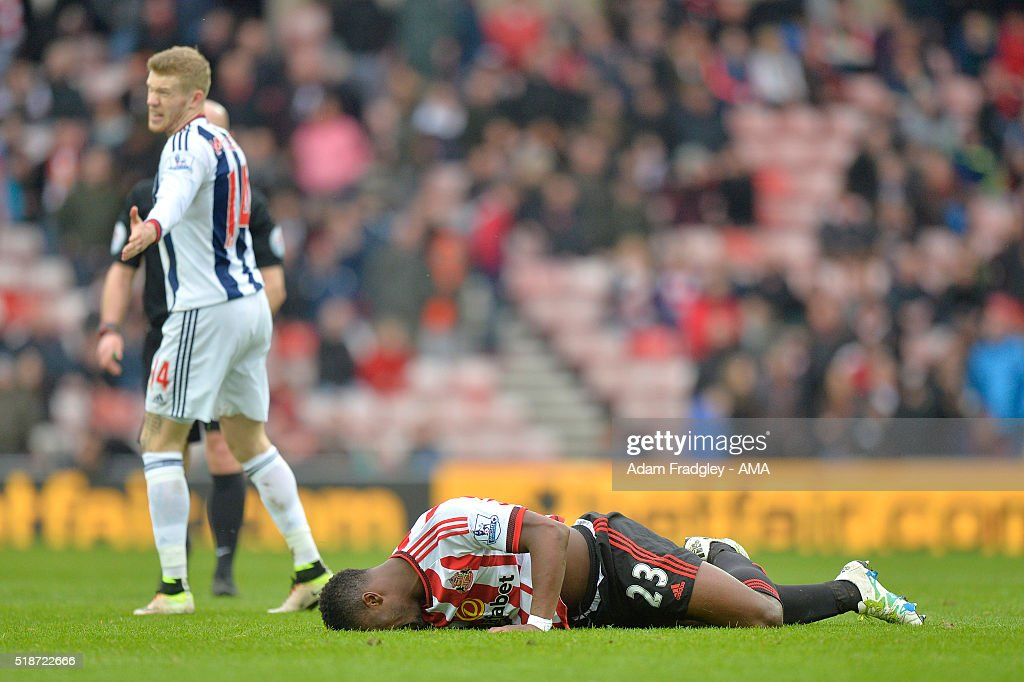 Lamine Kone of Sunderland reacts to a challenge from James McClean of West Bromwich Albion during the Barclays Premier League match between Sunderland and West Bromwich Albion at Stadium of Light on April 2, 2016 in Sunderland, England.