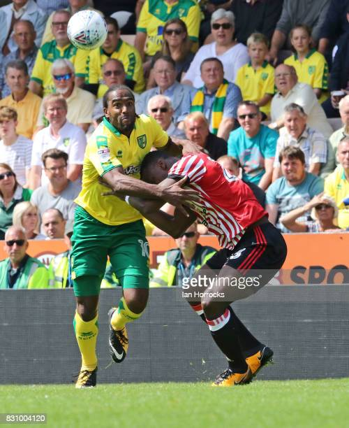 Lamine Kone of Sunderland tussles with Cameron Jerome of Norwich during the Sky Bet Championship match between Norwich City and Sunderland at Carrow...